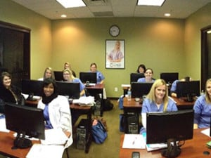Students sitting in a classroom at Academy of Dental Assisting in KY